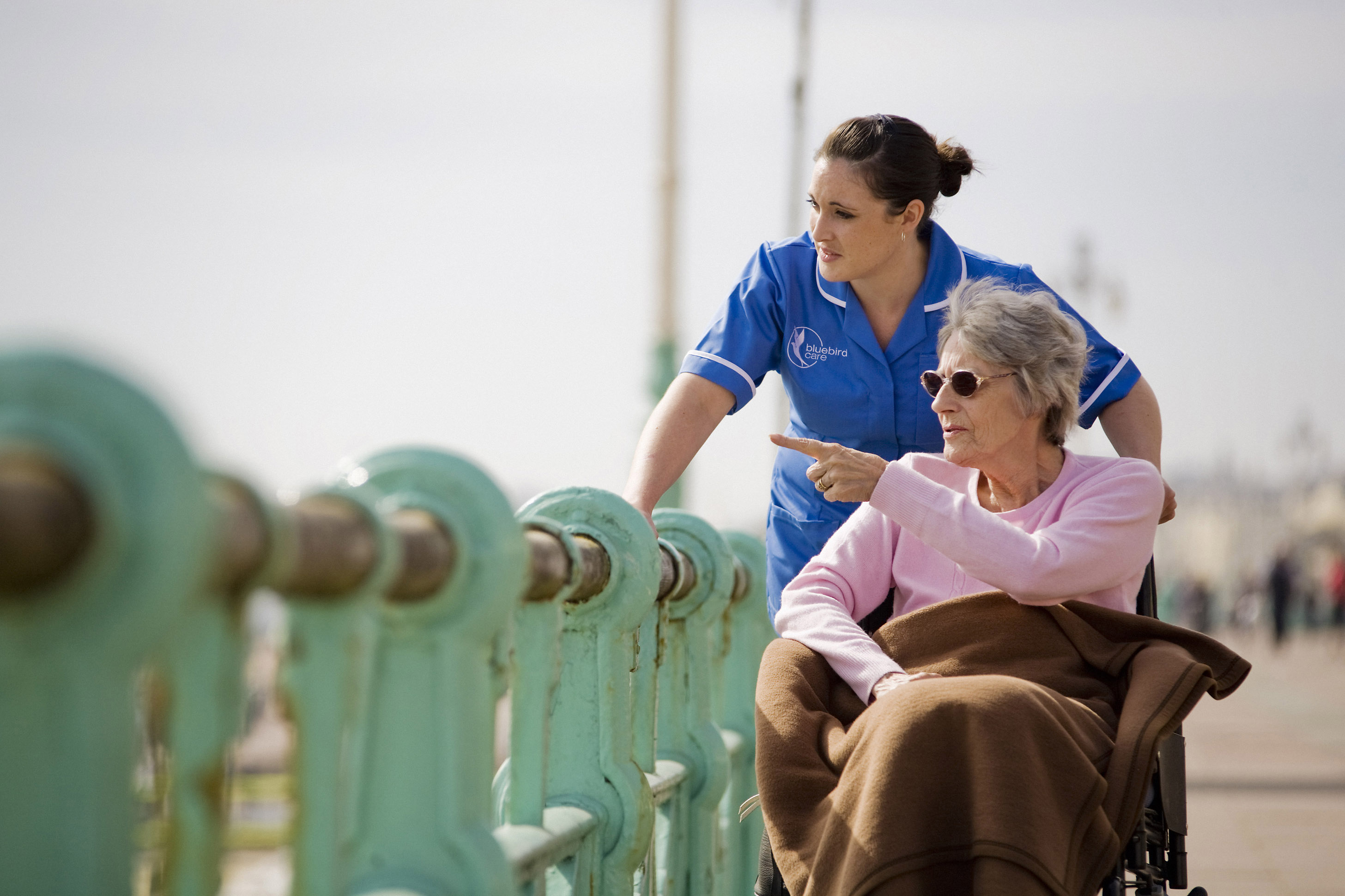 Live-in care, care worker and customer looking at a view
