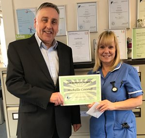 Michelle Conniff receiving her certificate