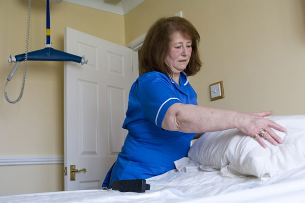 End of life care, carer making a bed
