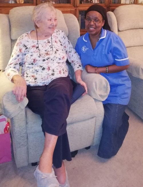 Live-in carer assistant with customer in their home