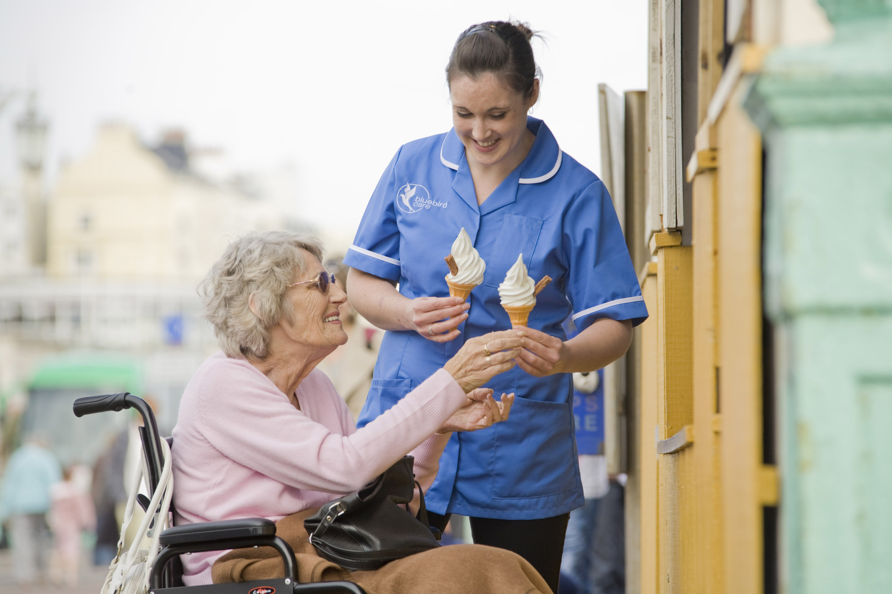Home care, carer giving ice cream