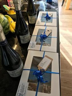 Gift boxes and champagne from Bluebird Care Cardiff North